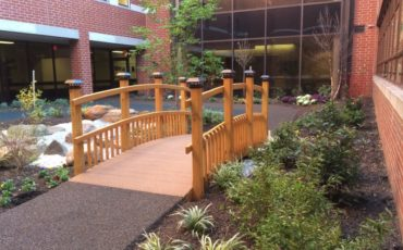 An arched bridge was planned as part of the many therapeutic elements within this healing garden