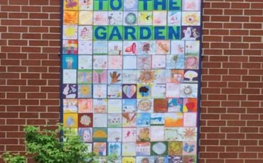 The children created a mural for the walls of this therapeutic courtyard garden
