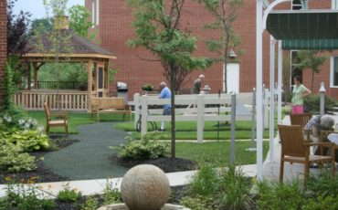Patients participating in therapeutic activities within the Physical Therapy Garden