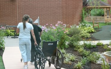 Therapist with patient utilizing the various walking path surfaces within the Physical Therapy Garden