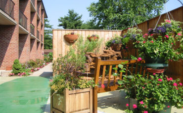 Providing a quiet sitting area within this rooftop Therapeutic Garden