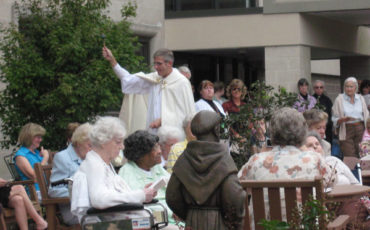 The blessing of the garden by the clergy at St. Francis Country House