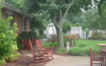 Sitting on a rocking chair within the Memory Care Garden is a wonderful way to sit and enjoy nature